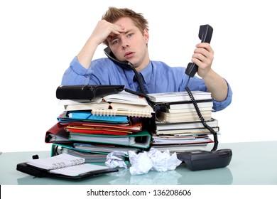 An overwhelmed businessman.