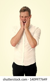 Overwhelmed concept. Man yawning face formal shirt white background. Man tired stressful yawn keep eyes closed. Guy with opened mouth yawns cover mouth hands. Stressful work in office.