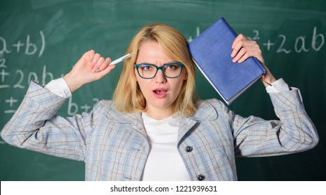 Overwork and lack of support driving teacher out of profession. Teacher woman with book chalkboard background. Why teacher quit off sick with stress. School toxic routine. Teacher stress and burnout.