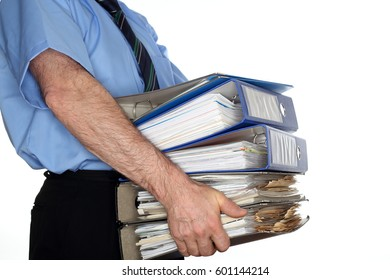 over-worked business man is taking many documents