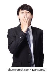 overworked business man yawning with black rim of eye isolated on white background, model is a asian people
