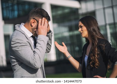 Overworked businessman is talking to colleague after work.
