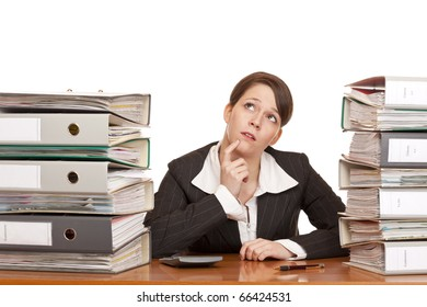 overworked contemplative business woman in office between folder stacks. Isolated on white background.