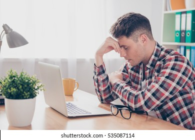 Overworked minded man having headache after working day