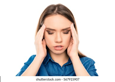 Overworked sad ill woman having strong headache.