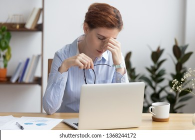 Overworked stressed business woman holding glasses feel eye strain fatigue after work, tired employee suffer from headache pain in dry eyes, bad blurry weak vision sight problem, computer syndrome