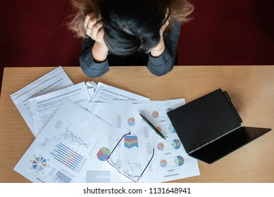 Overworked and tired businesswoman sleeping over a desk at work in her office. with a lot of paper.