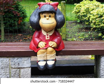 OVIEDO, SPAIN - AUGUST 5: Statue of Mafalda character in Oviedo, Spain on August 5, 2017. It is a tribute to Quino and it is located at San Francisco park.