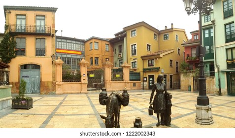 Oviedo, Spain - January 30, 2018:The milkmaid. Sculpture of Linares at the plaza Trascorrales in the center of Oviedo. Asturias, Spain.