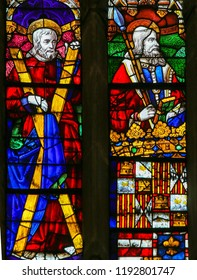 Oviedo, Spain - July  17, 2014: Stained glass window depicting Saint Andrew and Saint Thomas in the cathedral of San Salvador in Oviedo, Asturias, Spain.