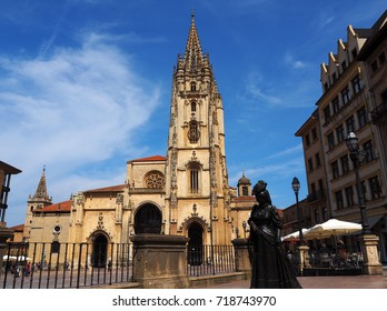OVIEDO, SPAIN - JULY 21: Cathedral and La Regenta sculpture in Oviedo, Spain on July 21, 2017. La Regenta is located in the Alfonso II square and is a tribute to the character and the literary work.