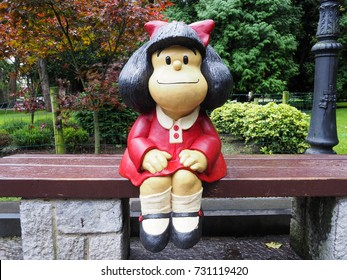 OVIEDO, SPAIN - SEPTEMBER 14: Statue of Mafalda character in Oviedo, Spain on September 14, 2017. It is a tribute to Quino and it is located at San Francisco park.