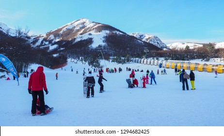 Ovindoli, province of L'Aquila, Abruzzo region / Italy - 01 05 2019: People of different ages, skiing with skis and snowboards in the ski resort Magnola, of Monte Velino mountains, central Italy.