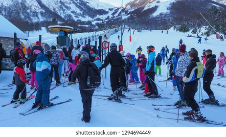 Ovindoli, province of L'Aquila, Abruzzo region / central Italy - 01 05 2019: People of different ages are waiting in the button ski lift going uphill in the mountains. Winter in the ski resort Magnola