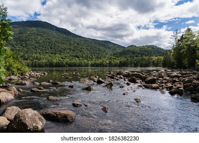 Owen Pond in Lake Placid, NY on a sunny day - Shutterstock ID 1826382230