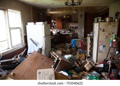 OWEN SOUND, CANADA - July 10, 2017: Litter and garbage strewn all over a domestic kitchen of an abandoned house.