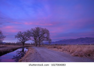 Owens Valley sunset with irrigation canal and the White Mountains long after the sun has set