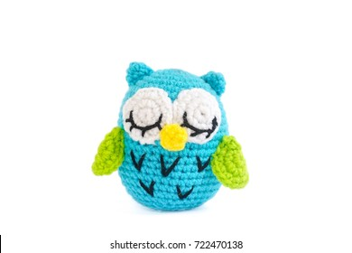 owl doll. a cute crochet doll of blue owl, isolated on white background