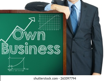 Own business on blackboard presenting by businessman