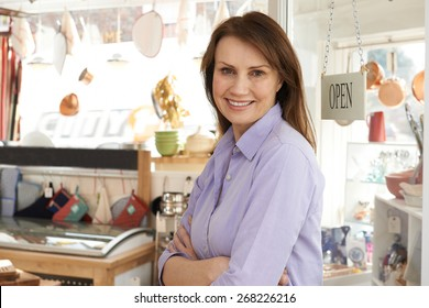 Owner Of Homeware Shop Standing In Doorway