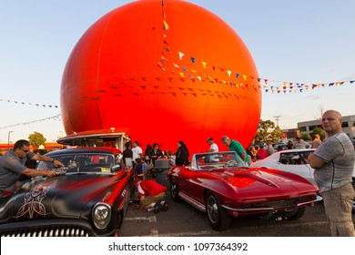 Owner standing proud and other people examining beautiful vintage cars during the Gibeau Orange Julep restaurant's classic car show in Montreal, Quebec, Canada, July 15, 2015
