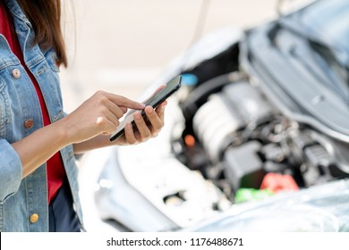 The owner of the vehicle using the phone internet connection contact car insurance to call car repair mechanic