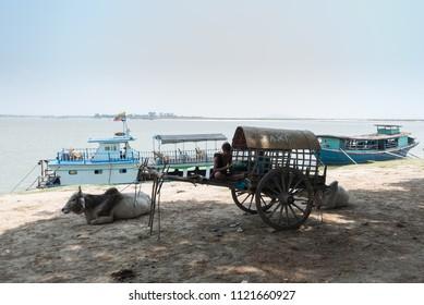 An ox cart by the river nears Mingun,  Myanmar (Burma) 21 Apr. 2018.