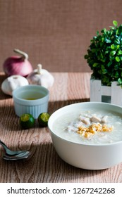ox tripe congee or also known as goto best topped with fried garlic and calamansi juice