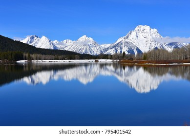 Oxbow Bend in Grand Teton National Park in the Spring on a beautiful clear day. With a reflection of snowy Mt. Moran in the water of the snake river