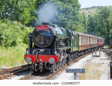 OXENHOPE, ENGLAND, JUNE 26 2018 Former London Midland and Scottish Railway steam locomotive 46100 Royal Scot arriving at Oxenhope on The Keighley and Worth Valley Railway, England.