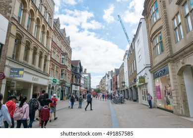 Oxford, England - 24 July 2016 - People walking, shopping around city on 24 July 2016 in Oxford, United Kingdom