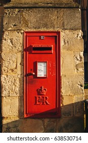 Oxford, England - 3 FEB 2013 : Royal mail post box mounted on the wall with shade of Sun