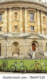 OXFORD / ENGLAND - JULY 01 2016: Lateral Facade of The Radcliffe Camera with Bicycles Outside of the Fence.