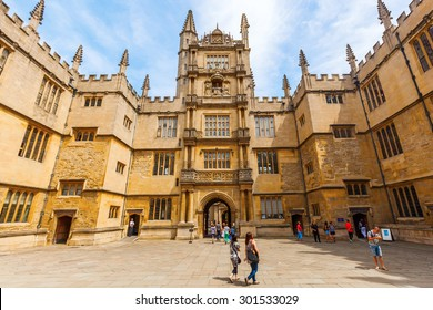 OXFORD, ENGLAND - JULY 03, 2015: Bodleian Library with unidentified people. Its one of the oldest libraries in Europe with over 11 million items and also a film location for Harry Potter and others