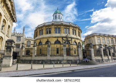 Oxford, England - July 10, 2010. A student sits on the stairs in front of the Sheldonian Theatre on July 10, 2010. Sheldonian theatre is one of the most important landmarks of Oxford.