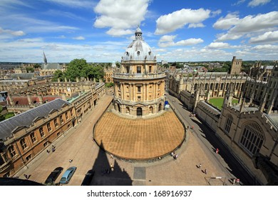 Oxford, England - July 11, 2010: Extremely wideangle photo of Radcliffe Camera, the square and surrounding colleges in Oxford, England, with blue sky and white clouds in background on July 11, 2010.