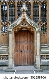 OXFORD, ENGLAND - JULY 2013:  This ornate door was added to the medieval Divinity School in the 1600s, and bears the initials of its famous architect, Christoper Wren, as seen in Oxford in July 2013.