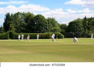 "OXFORD, ENGLAND - JULY 2ND 2017: On the most picturesque grounds, the ""Oxenford Cricket Club"" team is enjoying a game on the fields of the University of Oxford in England, on 2nd July 2017."