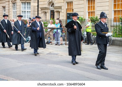 OXFORD, ENGLAND - JUNE 19, 2013: Official proctors and Academics process along Catte street to All Souls College of Oxford University at graduation day