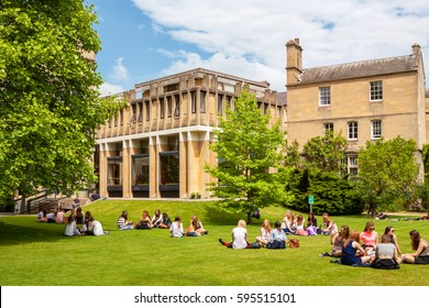 OXFORD, ENGLAND - JUNE 19, 2013: Students on the lawn outside Balliol College of Oxford University