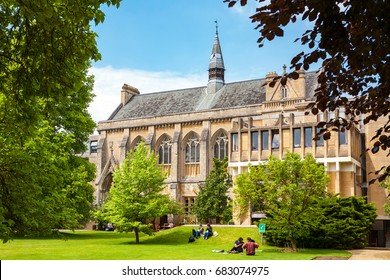 OXFORD, ENGLAND - JUNE 19, 2013: Students relaxing on the grass outside Balliol College of Oxford University
