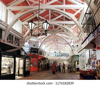 OXFORD, ENGLAND - JUNE 24, 2018: Tourists in the Covered Market in High Street, Oxford. The Covered Market is a historic market official opened on 1 Nov 1774 and is still active today.