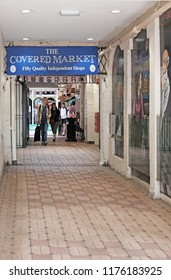 OXFORD, ENGLAND - JUNE 24, 2018: The Covered Market signboard in the corridor from High Street, Oxford. The Covered Market is a historic market official opened on 1 Nov 1774 and is still active today.