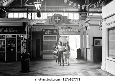 OXFORD, ENGLAND - JUNE 24, 2018: Visitors at the Covered Market's Golden Cross entrance from Cornmarket Street, Oxford. The Covered Market is a historic market opened on 1 Nov 1774 and is still active
