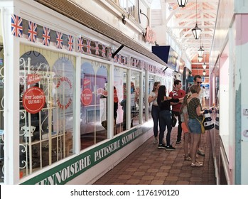 OXFORD, ENGLAND - JUNE 24, 2018: Customers in the Covered Market alley in High Street, Oxford. The Covered Market is a historic market official opened on 1 Nov 1774 and is still active today.