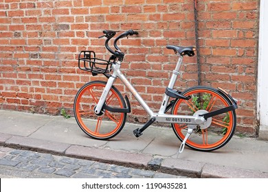 OXFORD, ENGLAND - JUNE 24, 2018: Mobike dockless bicycle in High Street, Oxford. Mobike is the world's first cashless and station-free bike sharing platform for short distance connectivity.