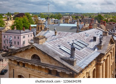 OXFORD, ENGLAND - MAY 15, 2009: The view from the cupola of Sheldonian Theatre to the roof of Clarendon Building with the nine lead statues of muses on the roof. Oxford University. Oxford. England