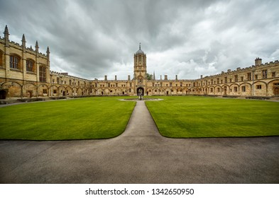 OXFORD, ENGLAND – MAY 15, 2009: Tom Quad, the largest quad in Oxford, is dominated to the west by Tom Tower.  In the center of square there is a fountain of Mercury . Oxford University. England