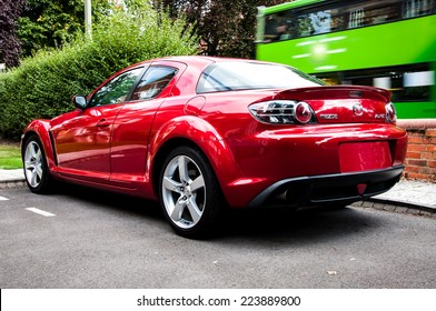 OXFORD, ENGLAND - OCTOBER 06, 2009: Parked Mazda RX-8 in red. The Mazda RX-8 uses a Wankel (Rotary) Engine.