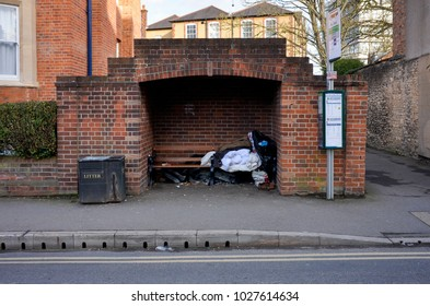Oxford England UK 02/16/2018: Homeless rough sleeping in bus shelter